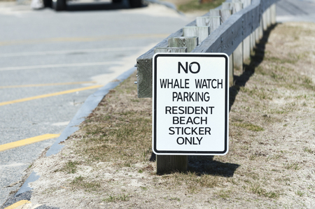 Sign indicates shortage of convenient parking at Cape Cod beach