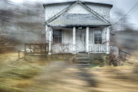 Motion blur speeding by abandoned house Stok Fotoğraf - 58302737