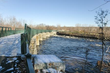 bikeway: Icy footbridge crosses Blackstone River Bikeway in Lincoln, Rhode Island Stock Photo
