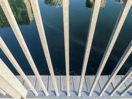 railing: Reflection of Boston waterfront skyline through railing