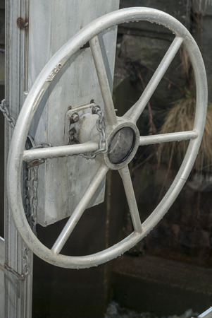 theft prevention: Chain around boats wheel serves as security