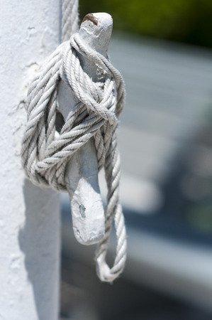 cleat: Halyard tied off to cleat on flagpole Stock Photo