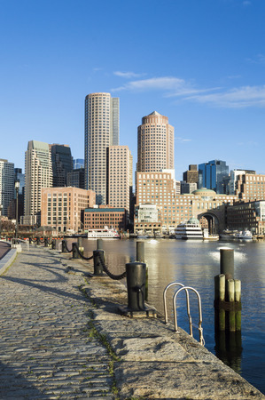 vertical format: Vertical format early morning view of Rowes Wharf from Fan Pier on Bostons Harborwalk Stock Photo
