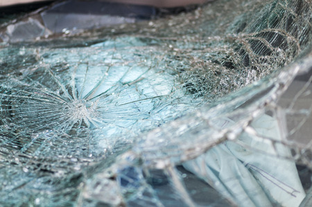 demolish: Automobile window warped into web of cracks from crash
