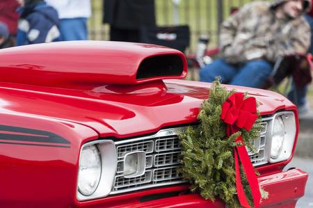 Taunton, Massachusetts, USA - December 5, 2010: Classic Plymouth sporting wreath in Taunton Christmas Parade Editorial