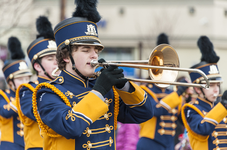Taunton, Massachusetts, USA - December 5, 2010: Trombone player into the music at Taunton Christmas Parade
