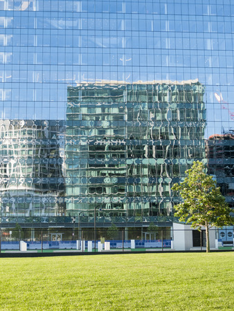 distorted image: Boston, Massachusetts, USA - July 24, 2016: Building reflects wildly distorted image of nearby building Editorial