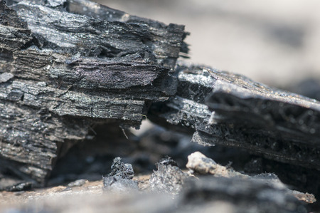 scorched: Scorched remains of fireworks casing left on beach Stock Photo