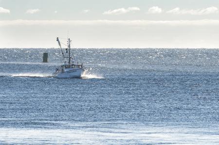choppy: Sandwich, Massachusetts, USA - September 14, 2014: Fishing boat returning from trip on windy Cape Cod Bay