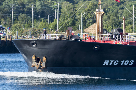 exiting: Cape Cod Canal, Massachusetts, USA - September 14, 2014: Prominent anchor on ship exiting Cape Cod Canal