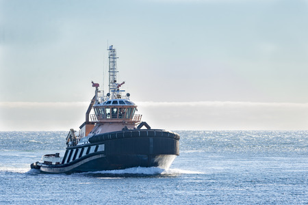 choppy: Sandwich, Massachusetts, USA - September 14, 2014: Tugboat returning from trip onto choppy Cape Cod Bay