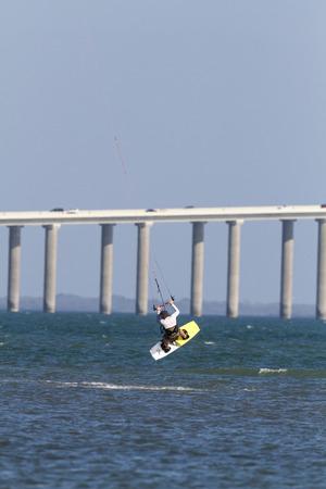 tampa bay: Tampa Bay, Florida, USA - February 28, 2011: Kiteboarders jump with Sunshine Skyway Bridge in background Editorial