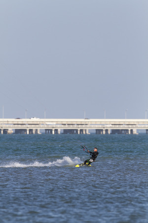 tampa bay: Tampa Bay, Florida, USA - February 28, 2011: Stylish kiteboarder cranks across small chop off Fort De Soto Editorial