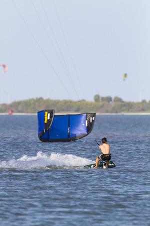 tampa bay: Tampa Bay, Florida, USA - February 28, 2011: Stiff breeze helps kiteboarder slash across Tampa Bay