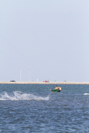 tampa bay: Tampa Bay, Florida, USA - February 28, 2011: Kiteboarder explodes off water in Tampa Bay