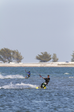 tampa bay: Tampa Bay, Florida, USA - February 28, 2011: Kiteboarders race across Tampa Bay on breezy afternoon Editorial