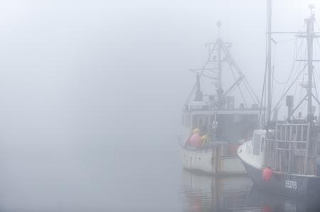 september 2: Westport, Massachusetts, USA - September 2, 2014: Fishing boats on foggy morning in Westport, Massachusetts