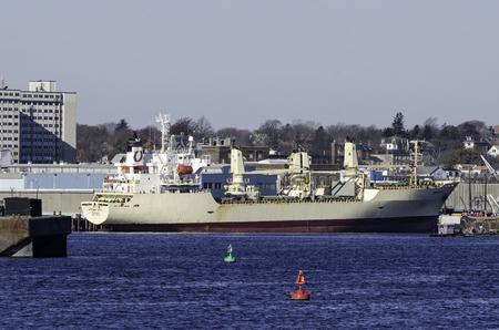 reefer: New Bedford, Massachusetts, USA - November 29, 2014: Cargo ship riding high dockside in New Bedford, Massachusetts
