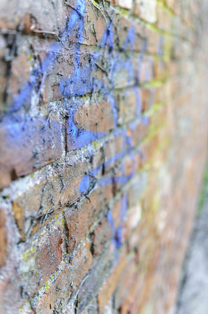 grime: Old brick wall covered with paint and grime