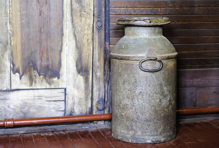 narrow gauge railroad: Portland, Maine, USA - August 10, 2009: Old milk can displayed at Maine Narrow Gauge Railroad Co & Museum