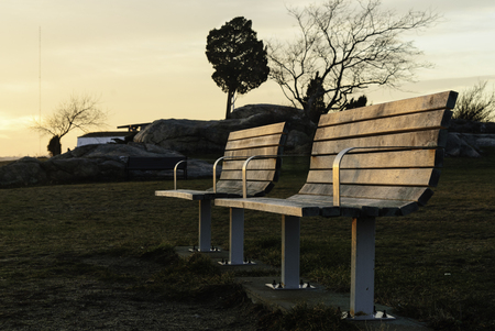 unoccupied: Unoccupied benches on winter evening Stock Photo