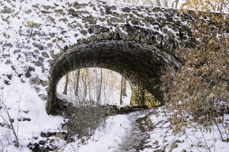 culvert: Stream bed under stone bridge culvert