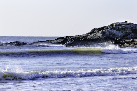 Small breaking waves at Allens Pond beach in Buzzards Bay