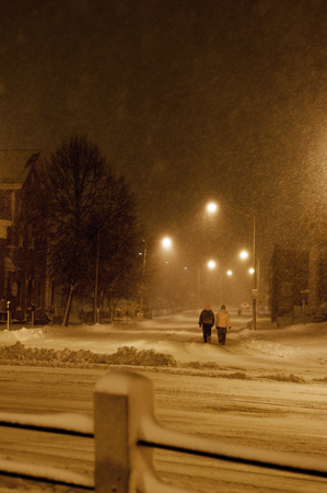 Snowstorm good time for stroll in the street 版權商用圖片