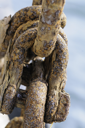 Cluster of corroded iron shackles on aging fishing boat Banco de Imagens