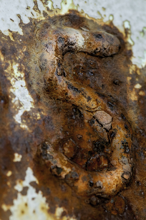 corroded: Rusting corroded numeral on side of fishing boat