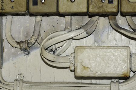 trawler: Aging electrical system aboard dilapidated fishing trawler Stock Photo