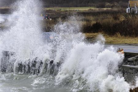 Powerful waves crash against retaining wall