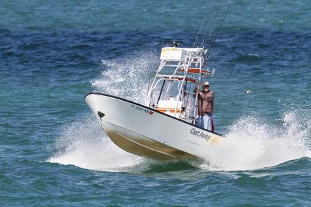 Tampa Bay, Florida, USA - February 28, 2010: Sport fishing boat hammering across choppy Tampa Bay Editorial