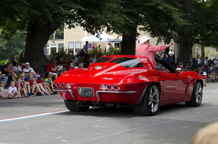 Bristol, Rhode Island, USA - July 4, 2011: VIP in customized Corvette at Fourth of July parade in Bristol, Rhode Island