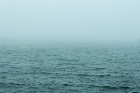 Choppy water on foggy spring morning on Buzzards Bay Stock Photo