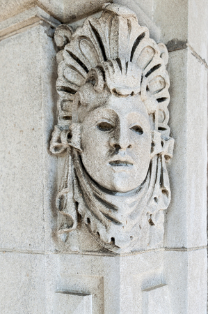 Fairhaven, Massachusetts, USA - July 4, 2017: Carved stonework near one entrance to Fairhaven High School, Fairhaven, Massachusetts