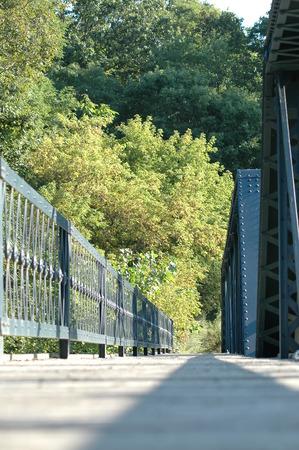 Pedestrian sidewalk on bridge crossing Blackstone River