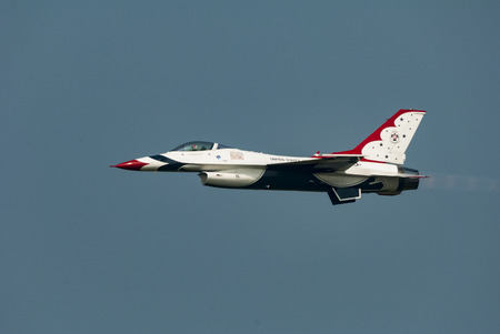 thunderbird: Cape Cod, Massachusetts, USA - August 24, 2007: United States Air Force Thunderbird in level flight at Otis Air Force Base airshow