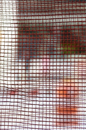 New York street through rusting wire mesh Stock Photo
