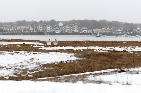 suggests: Scituate, Massachusetts, USA - January 7, 2009: A first glance suggests a couple is relaxing in adjoining bathtubs on a cold winter day along the Scituate waterfront Editorial