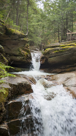 Water cascading down rocky hillside at Sabbaday Falls Stock Photo