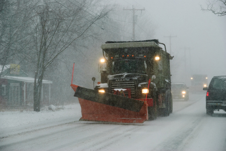 Seekonk, Massachusetts, USA - December 31, 2008: Snowplow ready for action in developing New England snowstorm