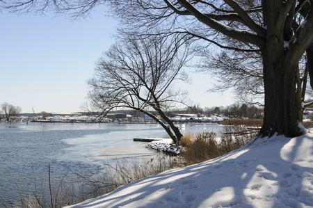 Ice and snow along Connecticut River shoreline Stock Photo