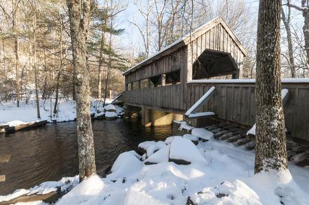 Covered bridge on winter day in Devils Hopyard State Park