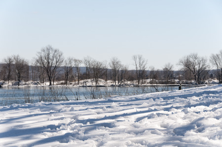 Snow-covered shoreline along small inlet on Connecticut River