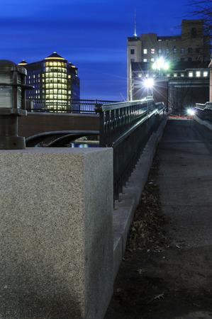Providence lighting up at dusk along river Stock Photo