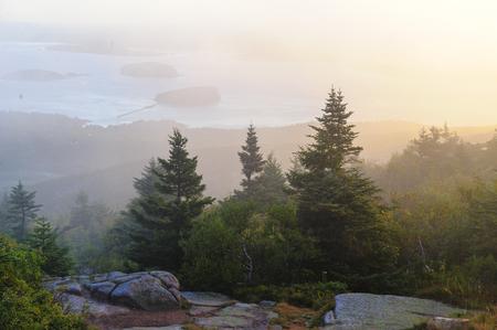Sunrise on misty morning at Cadillac Mountain Stock Photo