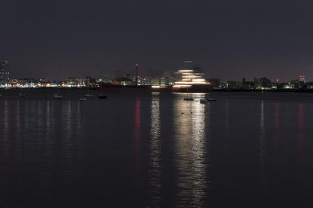Motion blur of ship gliding across Boston harbor in pre-dawn darkness