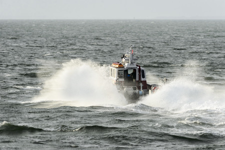 New Bedford, Massachusetts, USA - November 1, 2017: New Bedford Fire Rescue boat pounding through southeasterly chop en route to Buzzards Bay Editorial