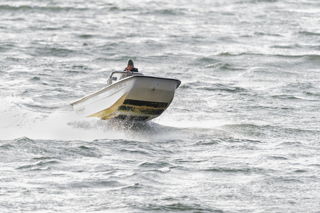 Fairhaven, Massachusetts, USA - November 2, 2017: Windblown chop makes for rough autumn ride on Acushnet River in Fairhaven, Massachusetts Editorial